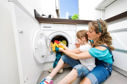Loading Laundry in Washer