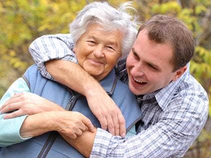 Man hugs his grandmother