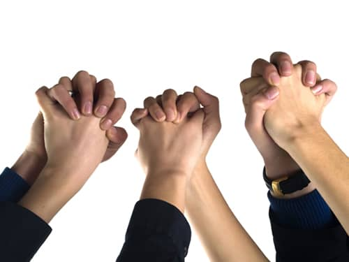 holding hands, giving support