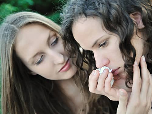 Young woman comforts her friend