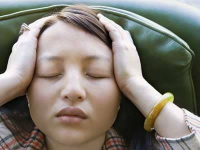Stressed young Asian woman