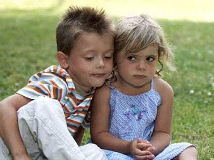 Young boy hugging young girl
