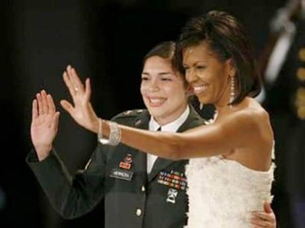 Michelle Obama with woman in military