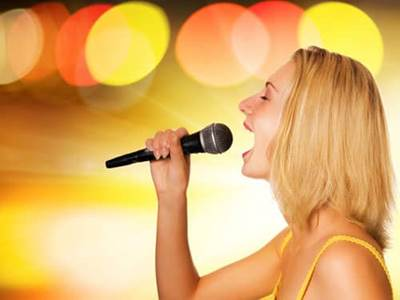 Woman singing loudly, karaoke