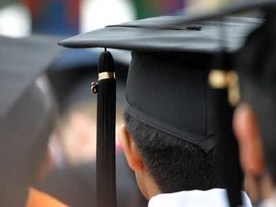 Graduate wearing a graduation cap