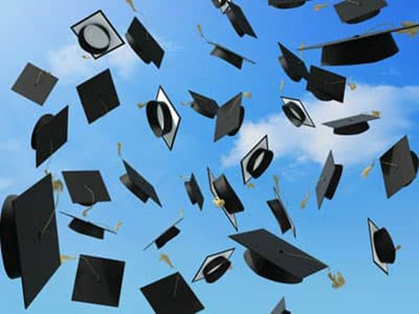 Graduate caps in the air