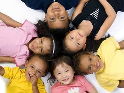 kids laying in circle