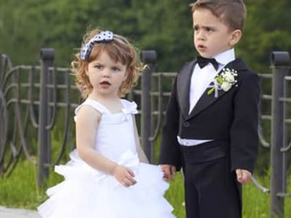 kids playing dress up wedding