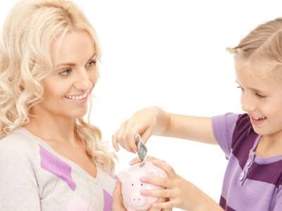 mom and kid saving money