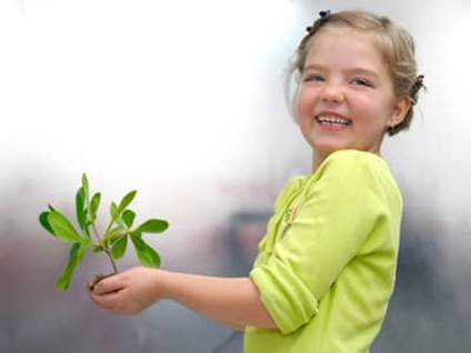 Green Kids_girl with plant