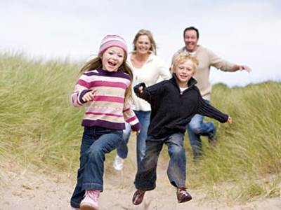 Parents and kids laughing together
