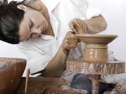Woman making pottery