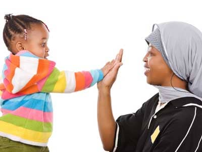 Mother and daught high-five