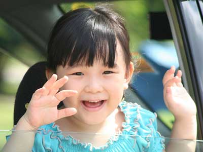 Little Asian girl waving good-bye