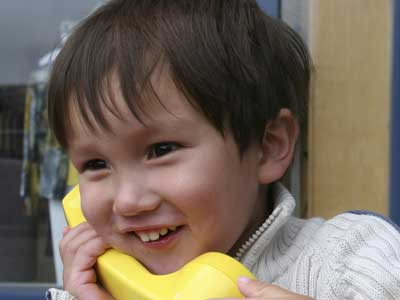 Little boy talking on the phone