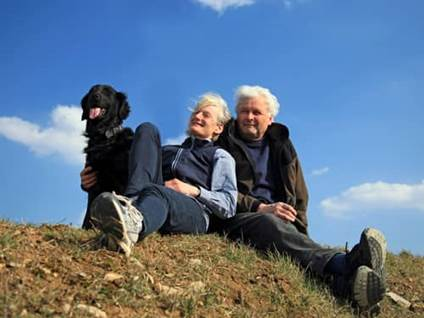 Elderly couple with a black dog