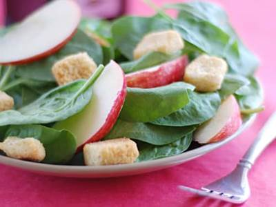 Apple, radish, crouton, and spinach salad