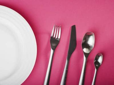 Plate with utenils fork knife spoons
