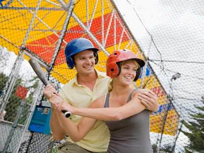 Man and woman playing baseball on a date