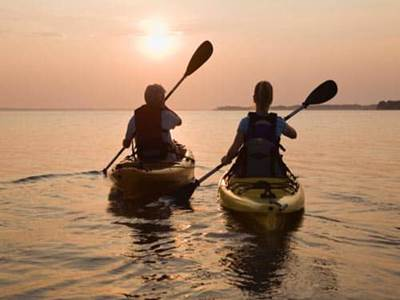 Man and woman kayaking on a date