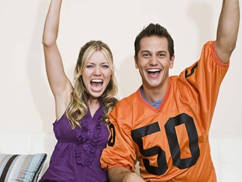 Man and woman cheering