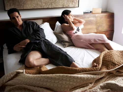 Couple in bed and upset
