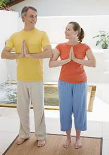 Man and woman doing yoga together