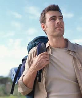 Man outdoors with backpack