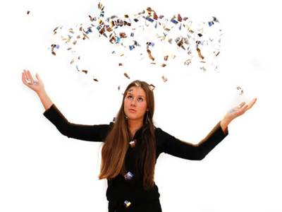 Woman with scattered confetti in the air