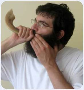 Blowing Shofar playing start month horn