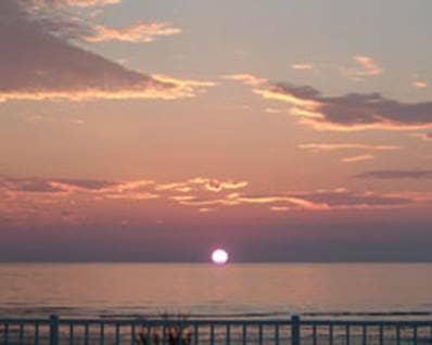 Home of Angels sunset sky horizon water orange red