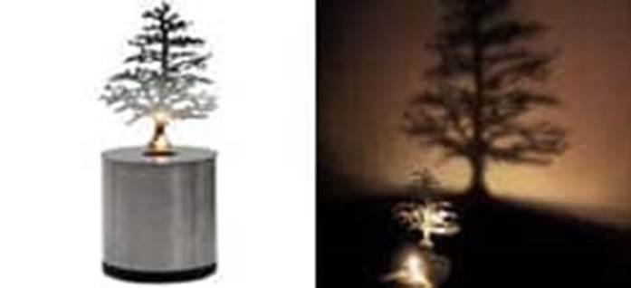 Lumen Oil Lamp casts a long pine tree-shaped shadow Made by Adam Frank