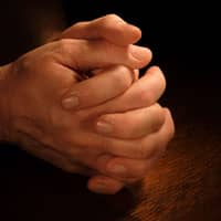hands clasped together