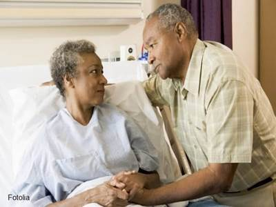 Man visiting woman in hospital