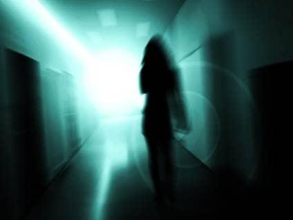 Silhouette moving toward light