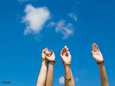 Four upraised hands and a heart-shaped cloud