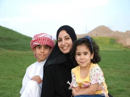 Muslim woman and two children