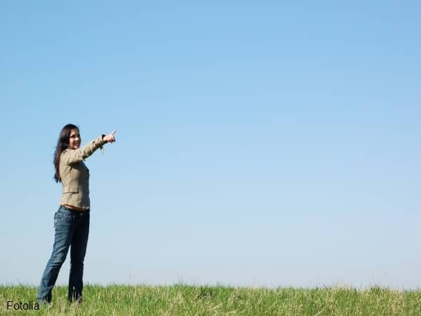 Woman pointing at something in the distance