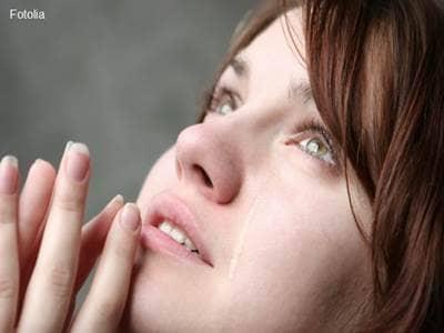 Teary-eyed woman praying