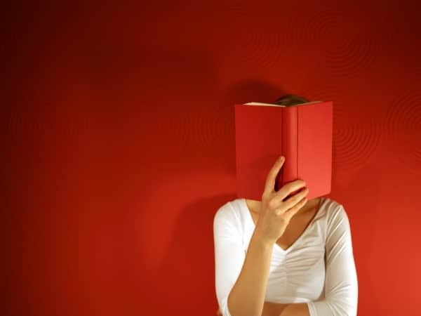 Woman with nose in a book