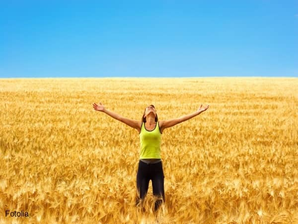 Woman rejoicing in a field of wheat