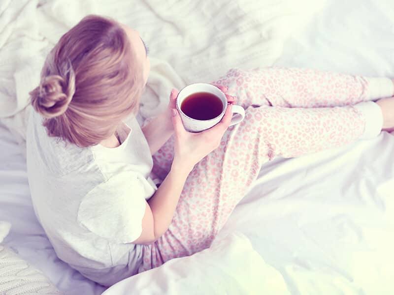 A woman wearing  pajamas.
